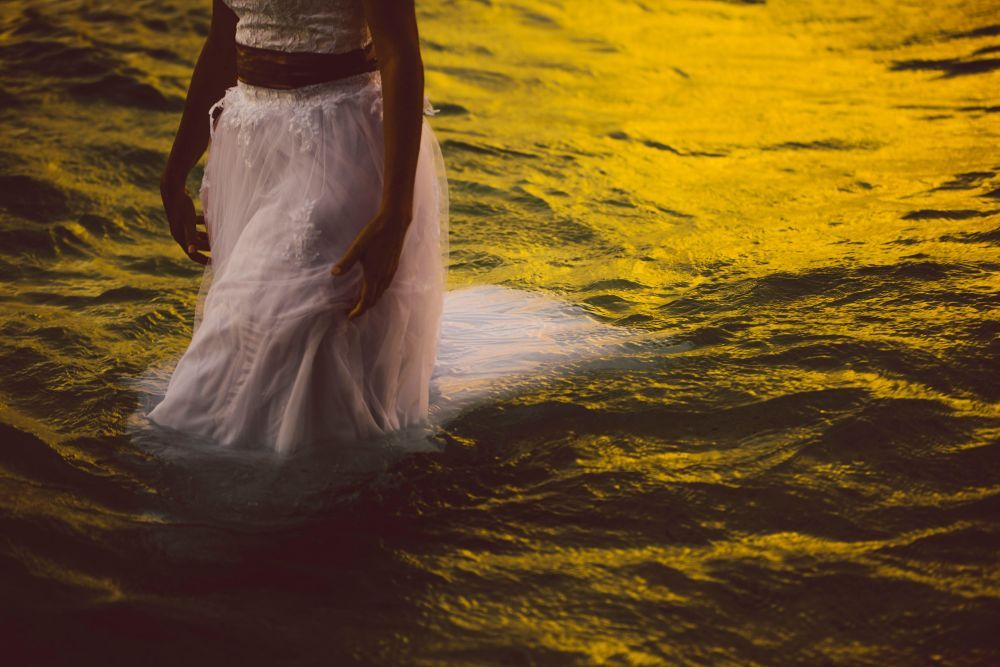 A bride swimming in the wedding gown