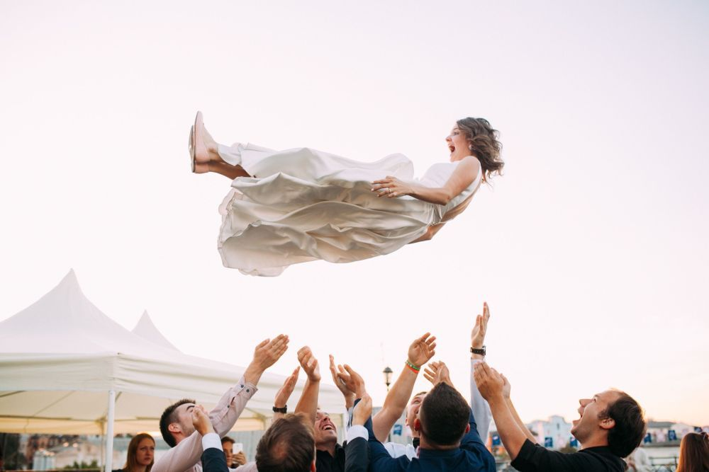A bride tossed up in the air